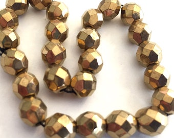 Vintage Czech beads (24) faceted crystal glass bronze gold coating shiny  7mm  (24)