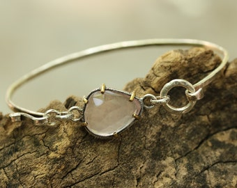 Faceted rose quartz with silver bangle bracelet