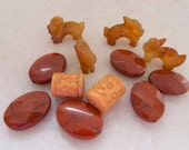 Whimsical Group of Faceted Oval Carnelian Gemstone Beads, Carved Carnelian Foo Dog Beads and Carved Bone Beads - Lot of 12