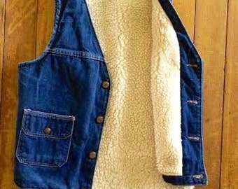 Vintage 1970's/1980's denim vest, sherpa lined super retro and perfect for cooler temps. size M