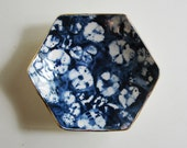 small shibori-inspired hexagonal porcelain dish with gold luster