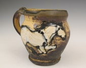 Large mug with slip trailed horses