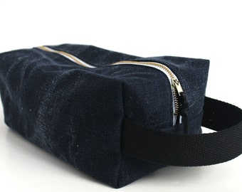 Distressed navy twill toiletry bag.