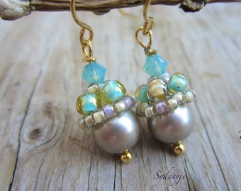 Swarovski pearl earrings with hand beaded bead caps in gold or silver