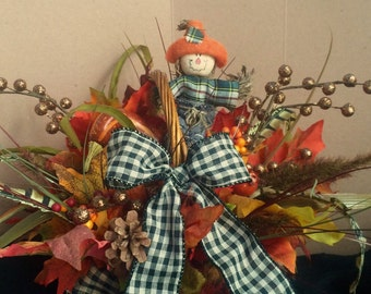 Autumn arrangement fall centerpiece scarecrow orange and yellow decorated basket toni kelly thanksgiving decor fall leaves