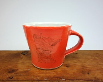 Made in Minnesota - Red glazed porcelain MN state mug with wave pattern