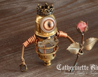 Little Steampunk Minion Robot King Sculpture holding a Rose.