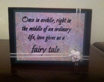Love Gives You a Fairy Tale Vinyl on Wood Block Saying With Flower