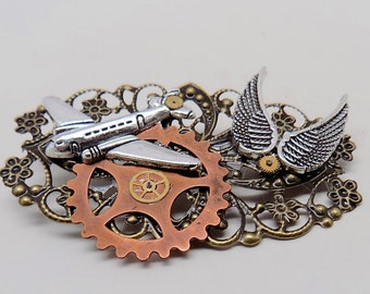 Steampunk airplane angel wings and gears brooch. Steampunk jewelry.