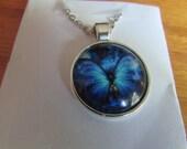 blue butterfly globe pendant necklace
