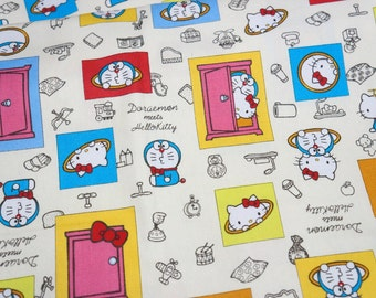 "ON SALE Hello Kitty and Doraemon 50cm x 106  cm or 19.6"" by 42 "" Half meter"