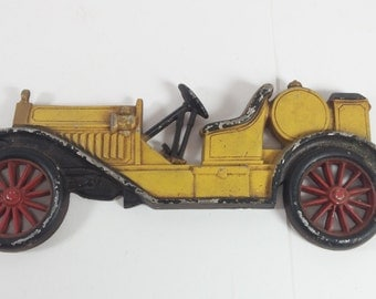 Vintage wall hang black and yellow cast iron car old car design made in usa