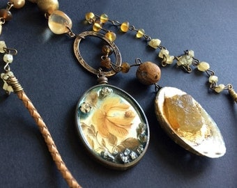 Heliotlatry. Golden rustic assemblage lariat necklace.