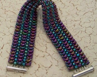 Iridescent Purple Superduo Beads with Aqua and Purple Seed Beads Wide Beaded Cuff Bracelet by Carol Wilson of Je t'adorn