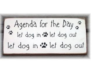Agenda for the day let dog in let dog out... wood sign