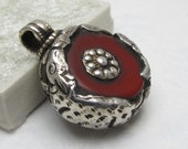 Tibetan Silver Repoussé And Red Copal Pendant