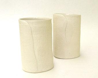 a pair of hand built porcelain vases  ...   cups  ...   matte vessels   ...   ceramic tumblers