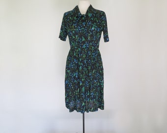JUNGLE // gorgeous green shelton stroller 50s or 60s graphic day dress