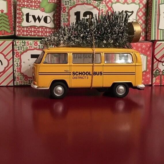 Vw school bus carrying christmas tree ornament by juniperjade