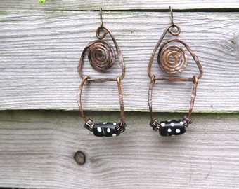 Primitive tribal earrings: Spirals of imagination ....