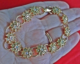 """Vintage gold tone 7"""" bracelet with pale yellow and aurora borealis coated rhinestones in great condition"""