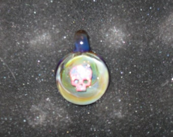 Handmade one of a kind borosilicate glass pendant with Gilson opal skull encased inside