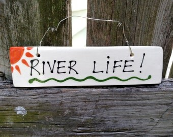 River Life hanging sign.
