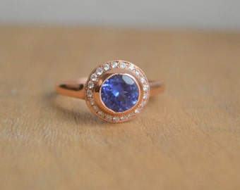 Tanzanite and Diamond Halo Ring in 14 Kt Rose Gold