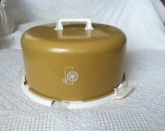 vintage plastic gold and off-white cake keeper/carrier