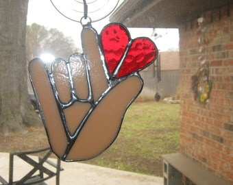 I love you hand shape with red heart sign language