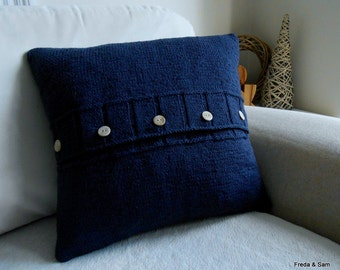 Large navy blue hand knitted pillow (cushion) with 5 brown shell buttons