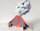 Small wooden sculpture - Erupting Volcano Wearing Rainboots