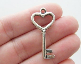 6 Key charms antique silver tone K20