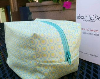 Cosmetic bag in teal and lime green circles