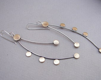 Modern, long architectural earrings: Dangling modern sterling silver and brass earrings with cascading discs