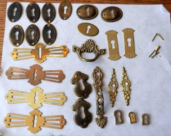 25 vint key hole covers stamped brass and cast brass. wood working, jewelry supplies. steam punk
