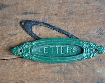 vintage cast iron ornate oval letters slot e2164