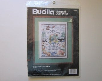 vintage cross stitch kit - PROTECT the BEAUTIFUL PLACES - Bucilla, unopened - circa 1990
