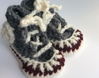 Crocheted high-top running shoe booties for newborn baby