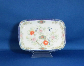Small Porcelain Tray with Oriental Design, White with birds in a flowering tree, floral design around the outer edge and dark blue rim