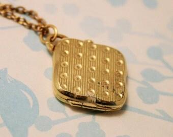 Vintage goldplated locket. Square locket