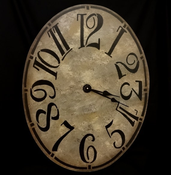 30 Inch Oval Wall Clock With Large Funky Arabic Numbers In