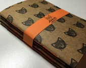 Cat cahier notebooks - sketchbooks - four handstitched hand trimmed A6 Kraft cat journals, unlined, hand stamped with unique cat designs