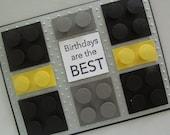Boys LEGO birthday card with Batman inspired colour LEGO bricks.  Birthdays are the BEST