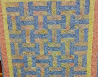 "Basketweave crib baby or lap quilt. 46"" x 46"". Machine pieced and quilted. 100% cotton. Machine wash and dry."