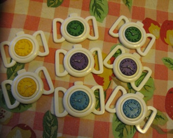 Children's Clock Buckles...new old stock...1950...assorted colors...lot/8