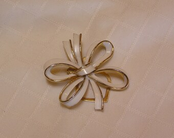 Crown Trifari white enamel quadruple bow and gold trim scarf brooch