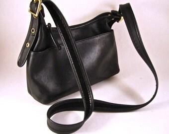 Coach 9136 black leather legacy small shoulder hand bag. adjustable strap.