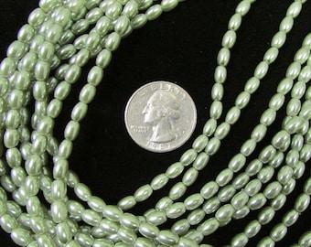 Glass Pearl strand 6x4mm rice Light Green(7a)
