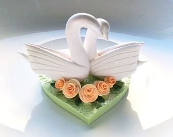 Swan wedding cake topper in pale green and soft peach handmade from polymer clay